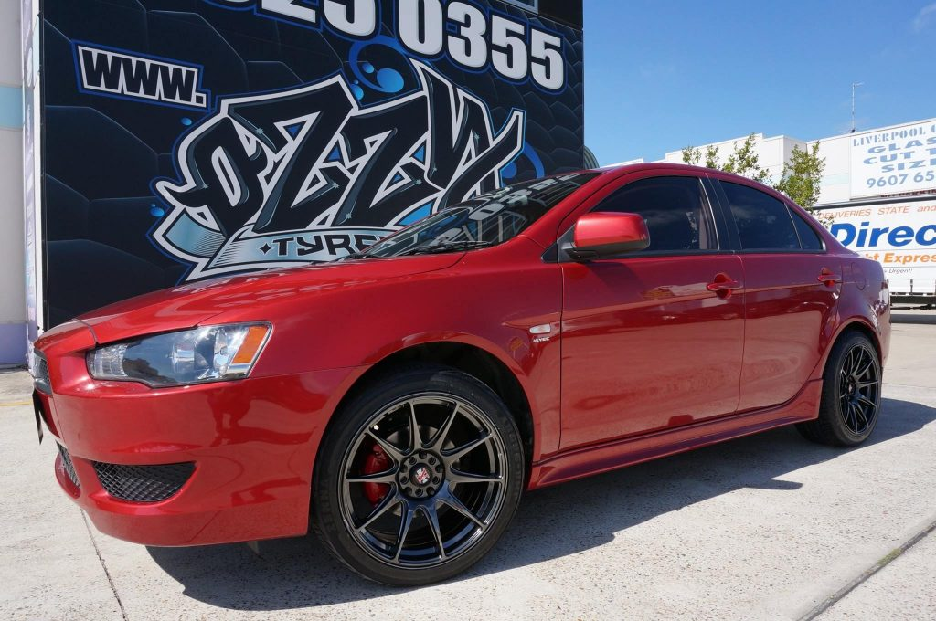 red-mitsubishi-lancer-with-kmc-xd-rims