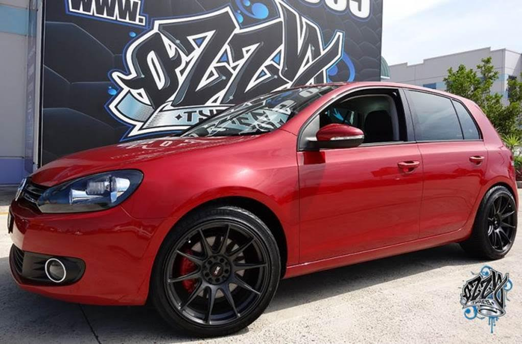 red-volkswagen-golf-with-black-rims