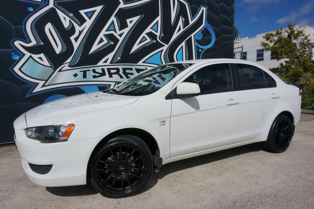 white-2016-mitsubishi-lancer-fitted-with-black-rims