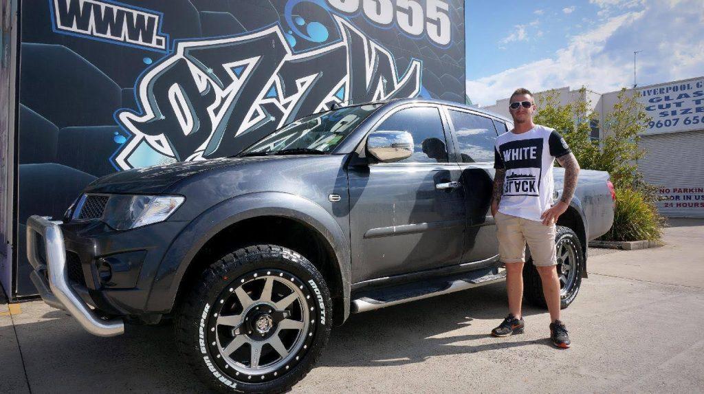 black-2017-triton-with-monsta-tyres-silver-rims