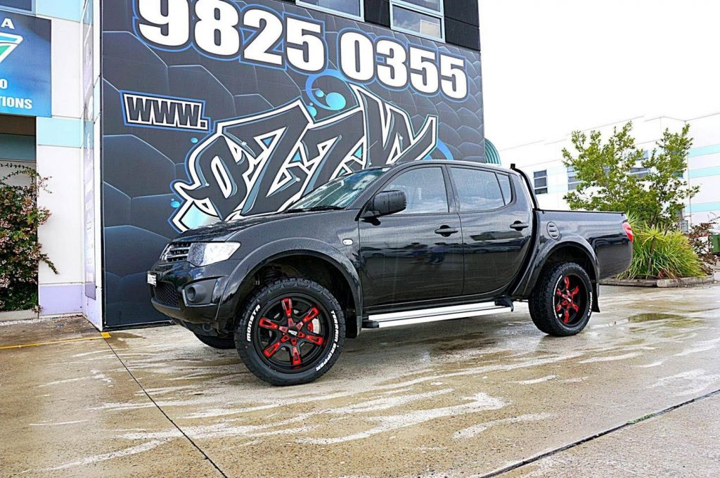 new-mitsubishi-triton-with-red-rims-monsta-tyres