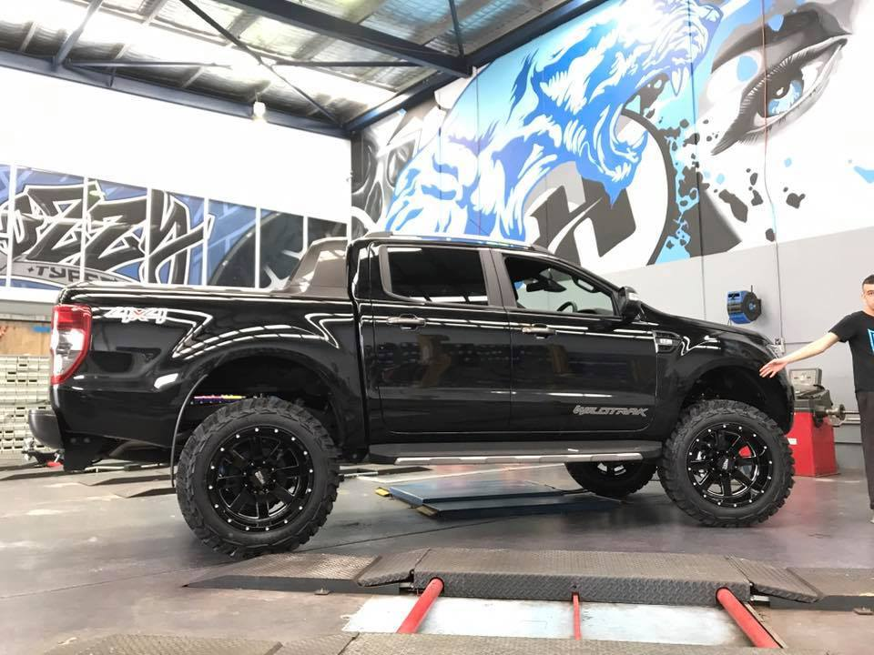black-ford-ranger-with-4x4-mag-wheels