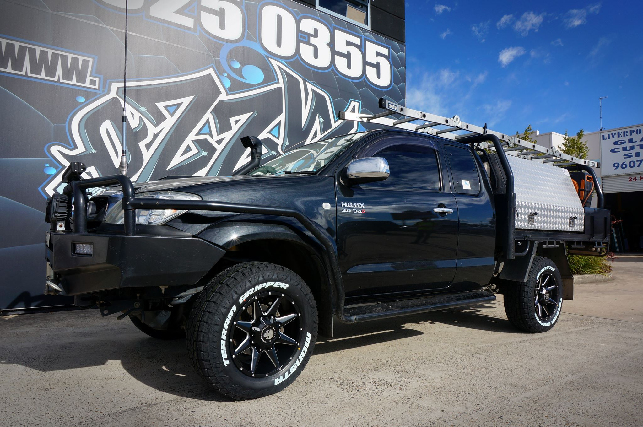 black-toyota-hilux-with-hussla-4wd-wheels-monsta-tyres