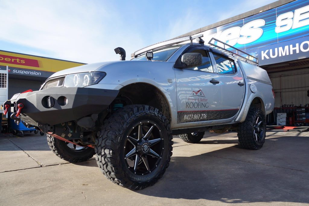 silver-4wd-mitsubishi-triton-fitted-with-black-hussla-4wd-rims