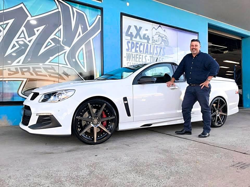 white-holden-hsv-ute-fitted-with-black-rims