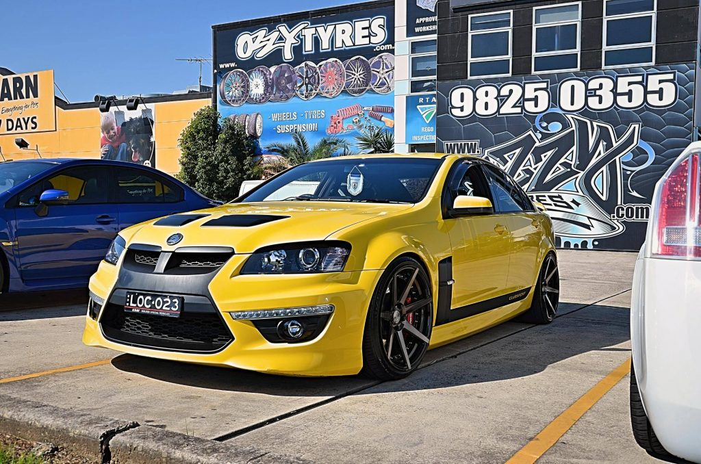 yellow-holden-hsv-clubsport-fitted-with-black-rims