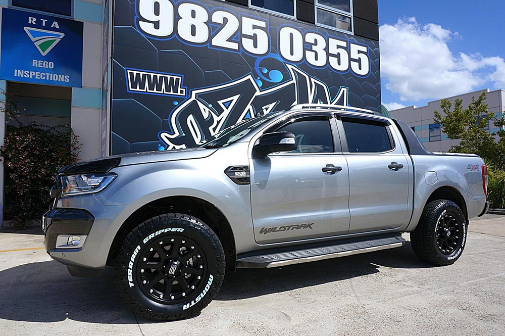 Silver Ford Ranger with Black Mags