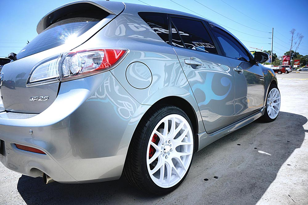 Mazda 3 with Hussla 030 in Matte White