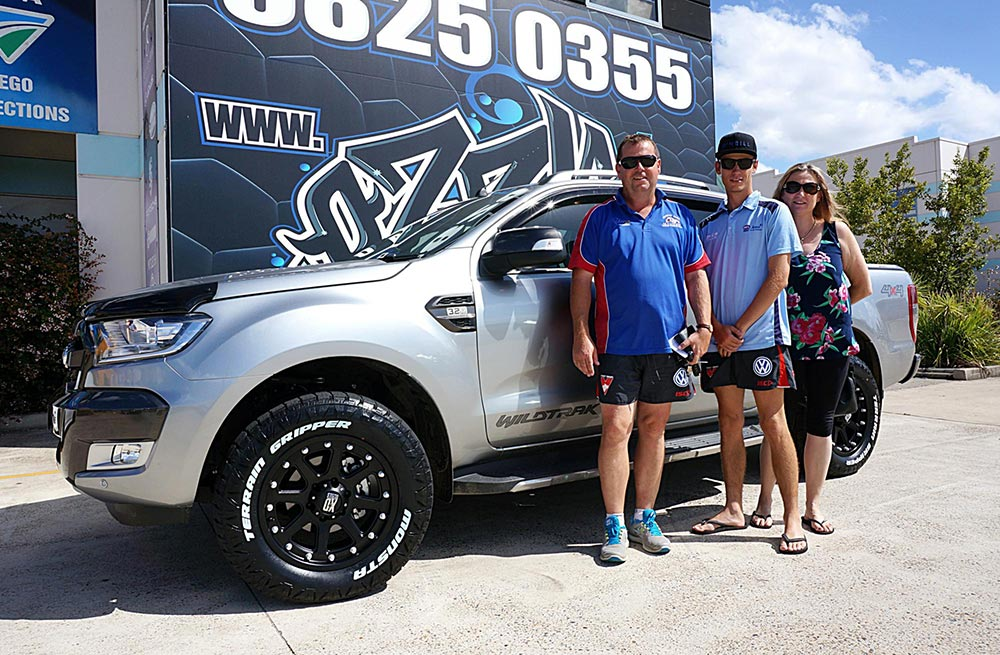 happy family with their ford ranger